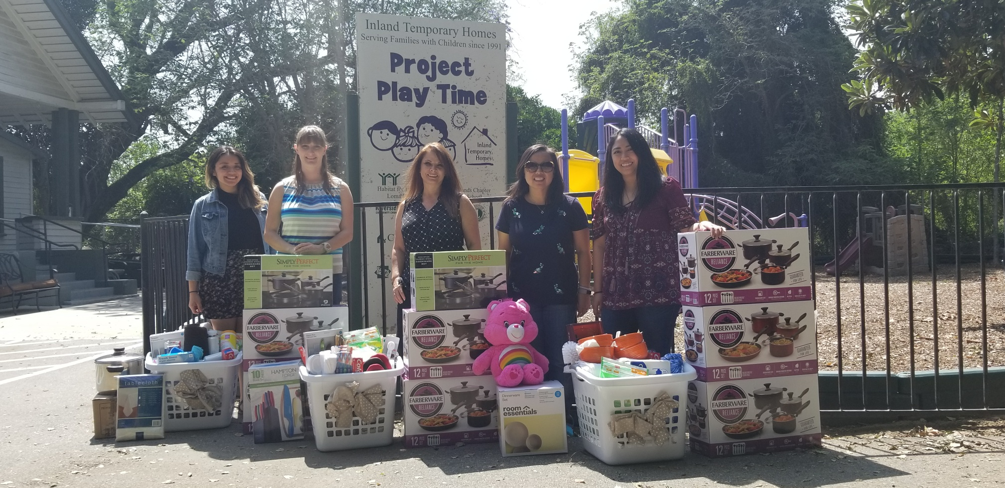 Phi Alpha students deliver laundry gift baskets to Inland Housing Solutions