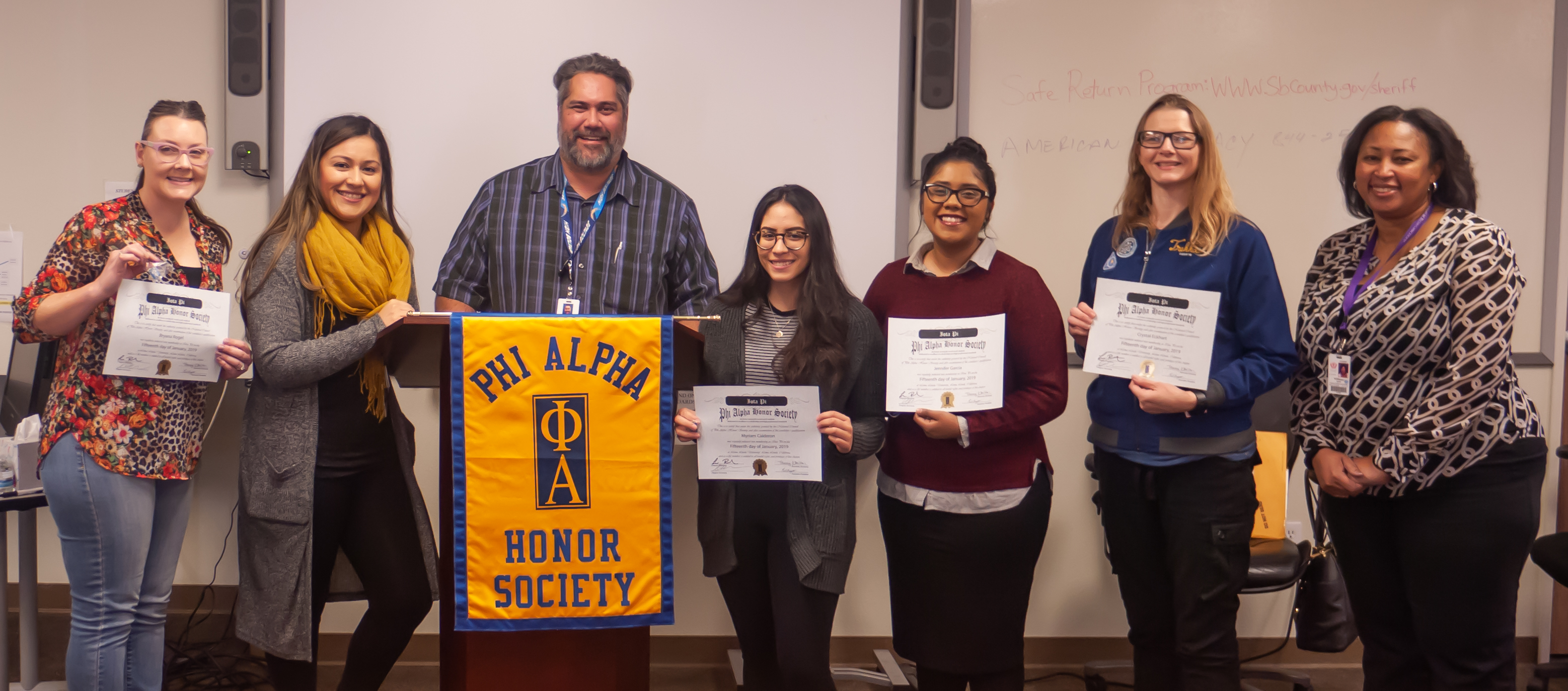 Phi Alpha honor society members and faculty advisor with awards.