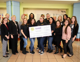 LLUCH receives check from Spirit of Children