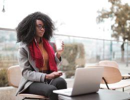 woman using laptop outdoors