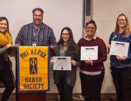 Phi Alpha honor society members and faculty advisor with awards.