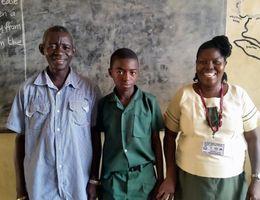 family in Sierra Leone classroom